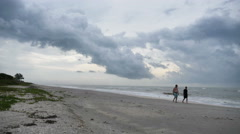 People on Beach with a Storm Coming Time Lapse on Sanibel Island Stock Footage