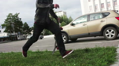 Skateboarder sprints and slides over the parapet. Stock Footage