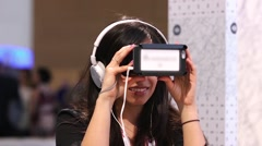 Woman using a virtual reality headset and headphones Stock Footage