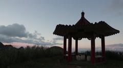 Chinese pavilion silhouette view from the TeaPot Mountain in Jinguashi town Stock Footage