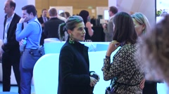 Group of business women talking at a corporate event - stock footage