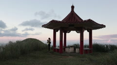 Chinese pavilion, asian woman take picture from the TeaPot Mountain, Taiwan-Dan Stock Footage