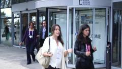 Rotating and revolving door with people entering and leaving a venue Stock Footage