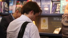 People in a bookshop or library Stock Footage