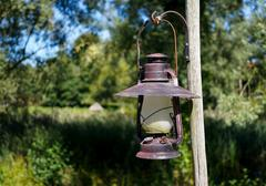 Vintage Kerosene lamp hanging outdoors - stock photo