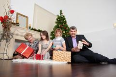 Happy family in the new year Stock Photos