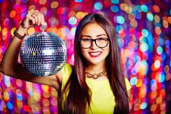 Holding disco ball Stock Photos