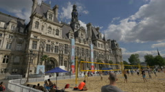 Playing volleyball next to City Hall in Paris Stock Footage