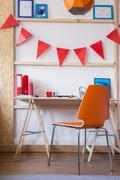 Bunting flags above the desk - stock photo