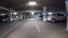 Pov drive through underground parking in shopping mall garage, - stock footage