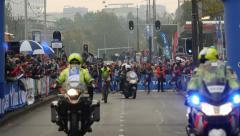 Pro runners at beginning of marathon Stock Footage