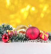 Christmas decorations on a golden background Stock Photos