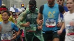 Close shot runners at marathon Stock Footage