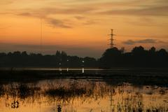 Silhouette of high voltage post with Huayyang reservoir Stock Photos