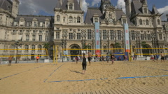 Sand volleyball in front of Hotel de Ville of Paris Stock Footage