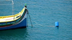 Fore of national maltese bout luzzu in malta harbour - stock footage