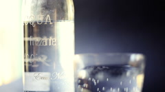 macro close up of a bottle and glass of sparkling water - stock footage