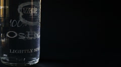 a still life bubbles of a bottle sparkling water in a blue dark background - stock footage