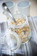 Healthy granola in glass jar - stock photo
