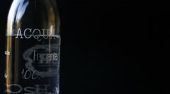 a close up still life of a bottle of sparkling water with bubbles - stock footage