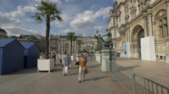 Walking and playing volleyball in front of the City Hall, Paris Stock Footage