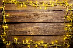 The wooden table with Christmas decorations - stock photo