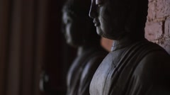 Wooden Buddha indoor. Handheld - stock footage