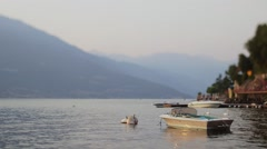 The beautiful shores of Lake Como and the Italian Alps in background. Sunset Stock Footage