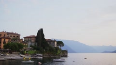 The beautiful shores of Lake Como and the Italian Alps in background.  Stock Footage