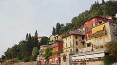Lake Como with the town of Varenna and the Italian Alps in background. Stock Footage