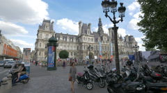 Motorcycles and bikes rental parked in City Hall Plaza in Paris Stock Footage