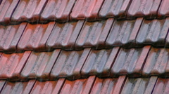 Stock Video Footage of Old clay roofing tile on heavy rain