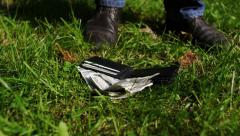 Man almost loses his wallet in a grass. Stock Footage