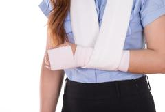 Close-up injured arm wrapped in an Elastic Bandage Stock Photos