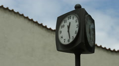A three sided clock on the street in Prague Stock Footage