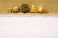 Golden Christmas decoration and advent candle. Stock Photos