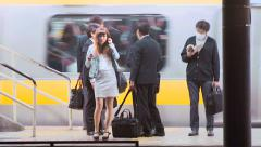 Woman waiting to board a train at the subway station in Tokyo Stock Footage