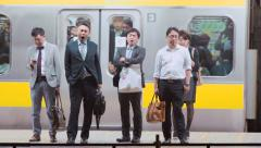 People yawning in slow motion on the station platform Stock Footage