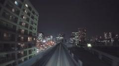 POV real-time ride through Tokyo via the Yurikamome Stock Footage