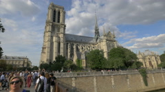 Walking on Pont au Double, next to Notre-Dame de Paris Stock Footage