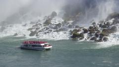 Niagara Falls Sightseeing Boat Sailing Past American Falls From Ontario, Canada Stock Footage