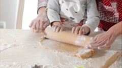 Housewife with her daughter preparing gingerbread Stock Footage