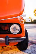 Closeup view on a headlight of a classic car Stock Photos