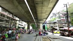 Street market under highway overpass Bangkok 2 Stock Footage