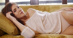 Sensual Girl Lying on Sofa at Her Home - stock footage