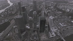 Aerial. The camera freezes over Moscow-City. The tone, from BW to colour. 4K. Stock Footage