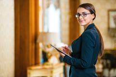 Concept for businesswoman in expensive hotel - stock photo