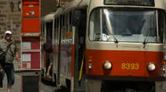 Boarding a red tram in Prague Stock Footage