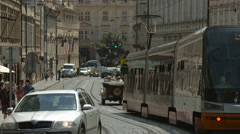 Tram and cars on a street in Prague Stock Footage