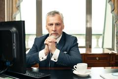 Concept for businessman in expensive office Stock Photos